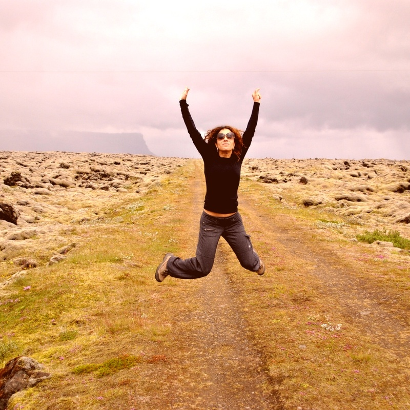 KathyJalali jumping on top of a mountain in Iceland